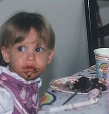 Being a Messy Kid Eating Cake