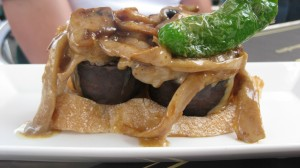 Blood Sausage topped with mushrooms and fried pepper